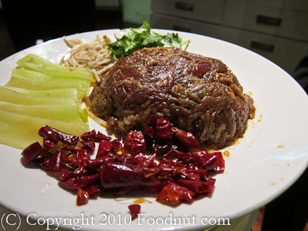 South Beauty Shanghai fried sliced beef tender with stones in hot oil